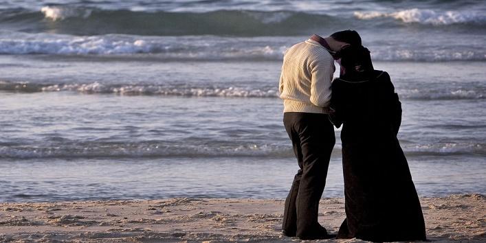 Palestinian couple on a beach