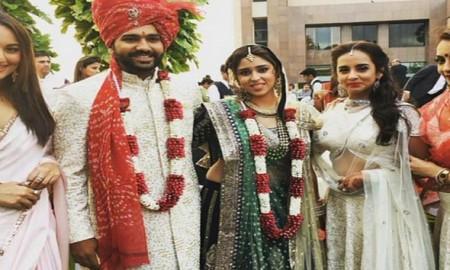 Mumbai: Newly wed couple cricketer Rohit Sharma and Ritika Sajdeh pose for a photo at their wedding venue in Mumbai on Sunday. PTI Photo by Mitesh Bhuvad(PTI12_13_2015_000236B)